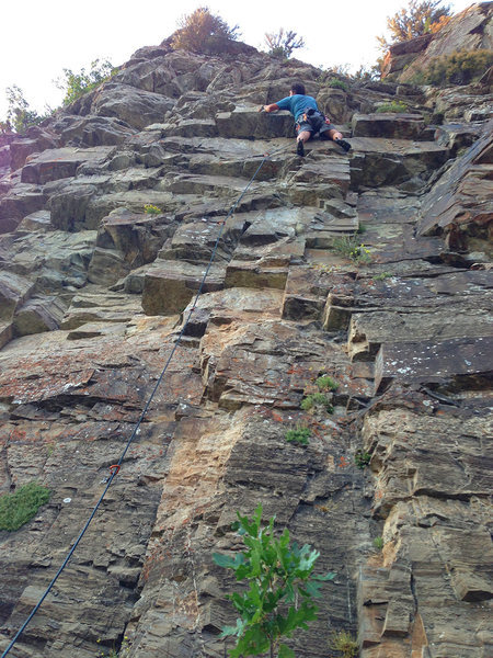 Rock Climbing Photo: Aj clipping protection at the crux.