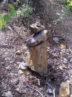 The cairn, take a left directly towards the wall. 30 seconds to go.