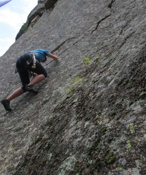 The lower crux is troublesome for thick-finger climbers.