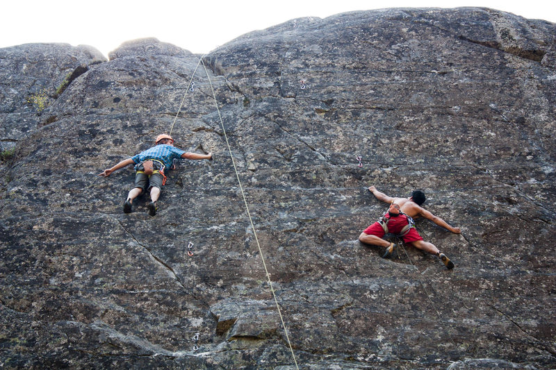Me hitting the crux of Duppy Conquer (5.11c). Alex on Step Into the Light (5.10c).
