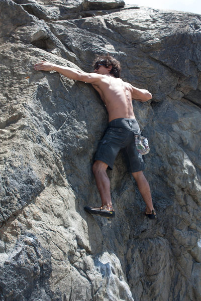 Gabriel working the crux. Three bolt anchor above his head for top roping.
