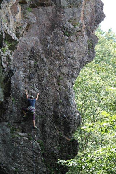 Jess climbing Orange Sunshine