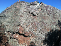 Rock Climbing Photo: Easy line up the East side.  Follow the crack at t...