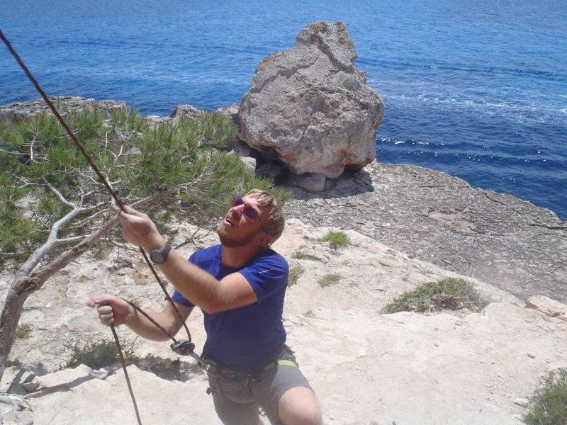 Belaying a sea-side climb on Mallorca