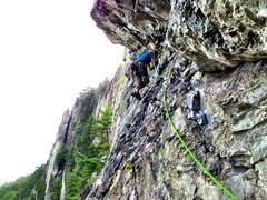 Jonathan leading pitch 2 of Pleasant Overhangs. Thin moves off the belay ledge.