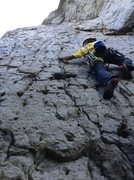 Rock Climbing Photo: Logan creeping towards the third bolt on Bonzai, a...