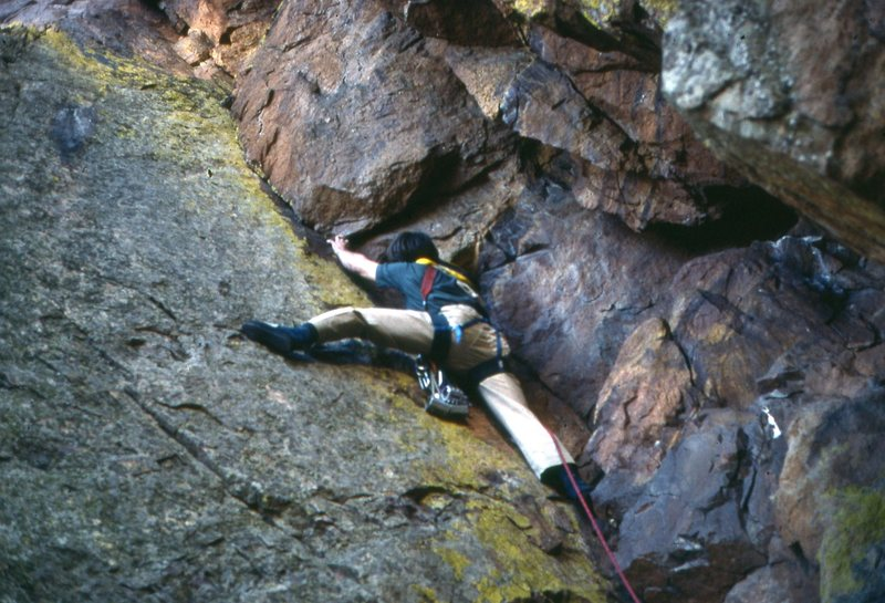 """George Bracksieck leading into the first crux of """"Quiche on a Leash,"""" in March, 1978. Notice the absence of a chalkbag. No-trace climbing meant no chalk, despite my oily skin."""