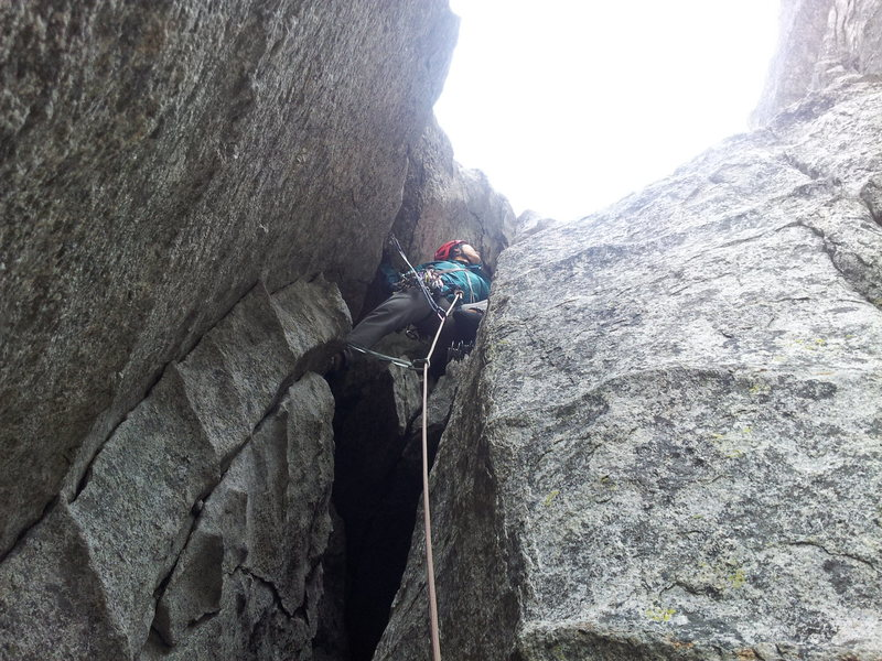 exiting the 3rd pitch chimney for the heady traverse right