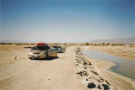 """Our mighty sedans (LOL) at the launch site... note how far the water has receded from the """"boat ramp."""""""