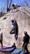 Rock Climbing Photo: Attempting the tricky crux move of Con Artist