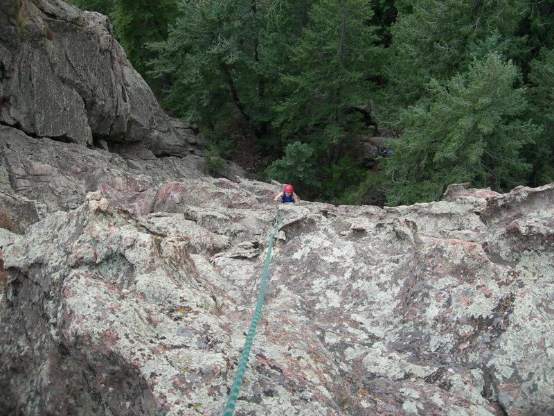 Deb just above the runout, steep 5.5 R section.<br> <br> Note the Love dihedral to Deb's right.