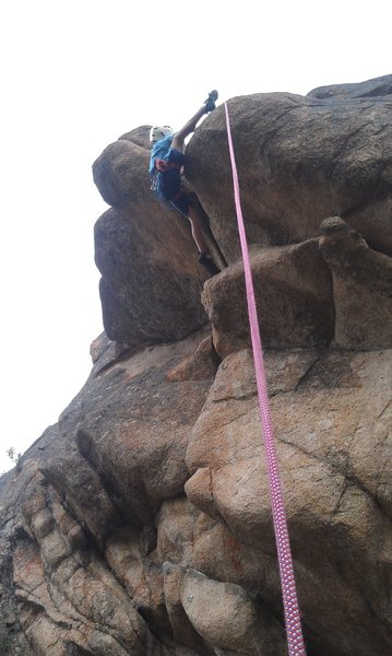 One of the kids of the Gunnison youth climbing club on the crux of Bambis's Belly.