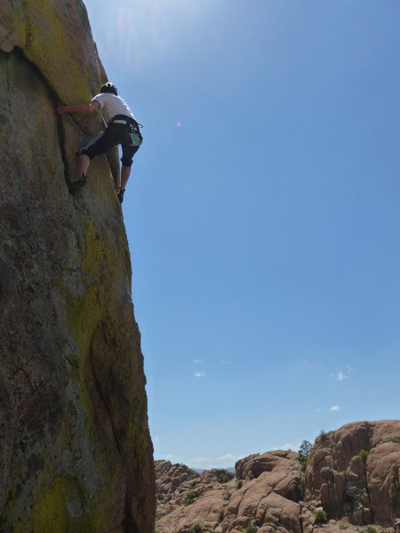 My wife finishing the traverse. This is a classic of the area and a lot of fun.