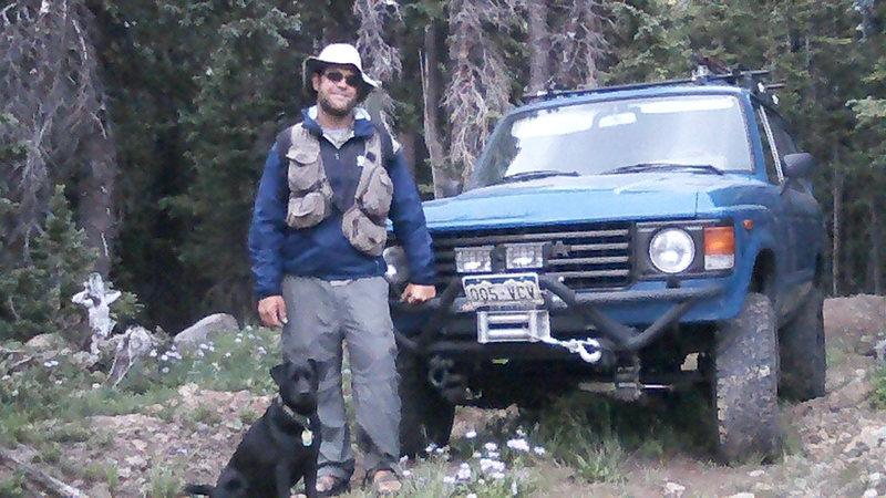 man dog truck