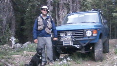 Rock Climbing Photo: man dog truck