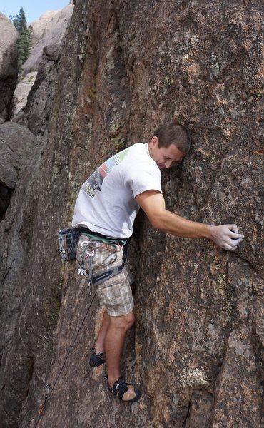 Micah climbs through the crux