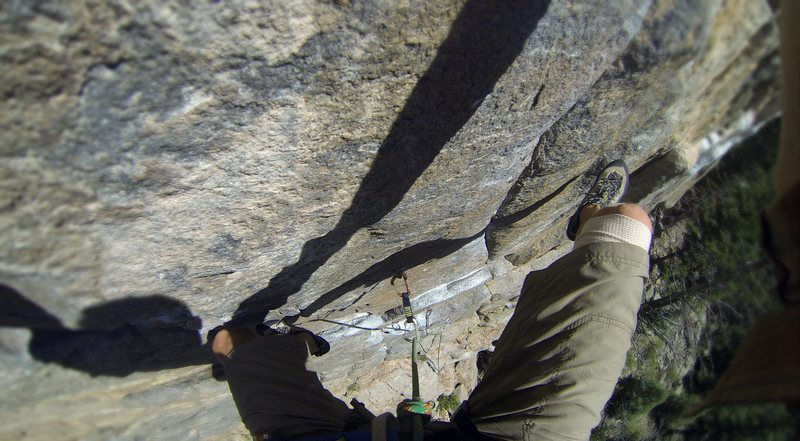 Looking down from the Onsight on Free Willie (5.11a) at Animal World in Boulder Canyon.