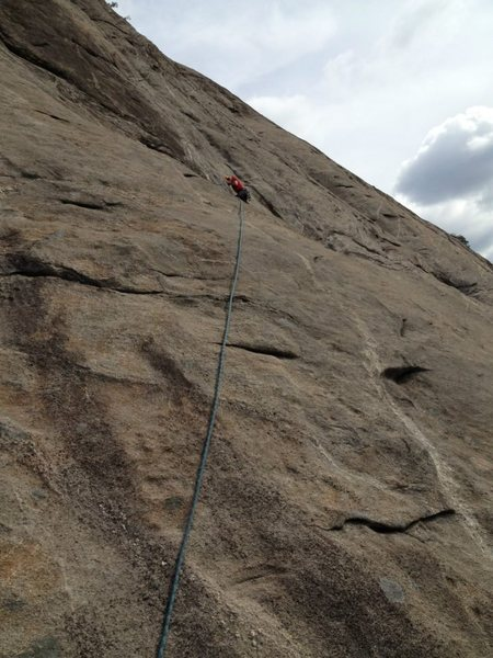 The rating of this route is not indicative of the difficulties. When the climbing tips into the 5.10 range it is protected with a bolt but the true challenges of this climb are keeping it together on 5.8 wandering slab way out over a bolt.
