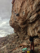 Alex Kirkpatrick demolishing the crux of No War (5.13c), the Beach on a wild Tucson winter day.  About fifteen moves in, few more to go.