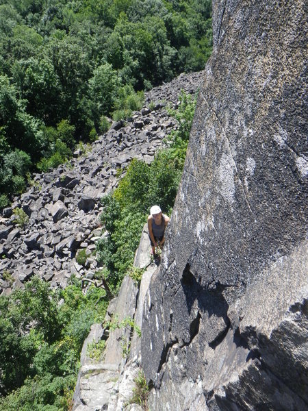 Looking back at the belay ledge after the first few moves