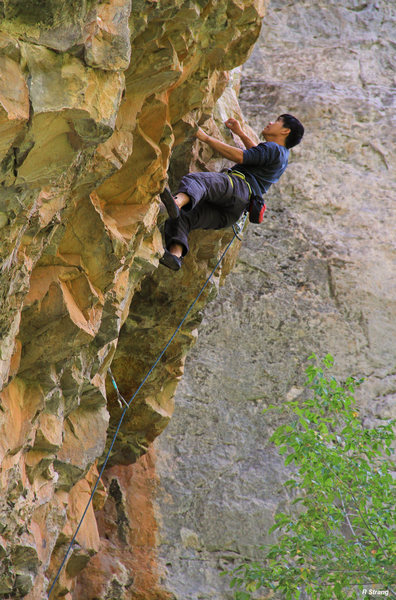Ben cruises to the 1st crux of Genesis (5.12a).