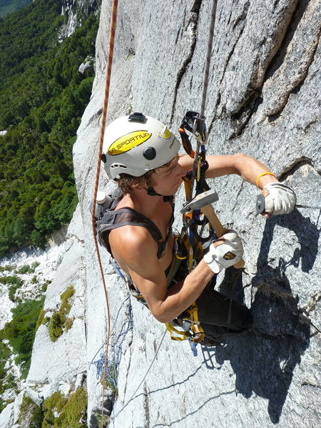 Shawn Wright putting in a bolt on the beautiful face-climbing arete of pitch 4.