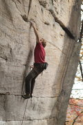 Rock Climbing Photo: Sticking the big deadpoint at the 3rd bolt.