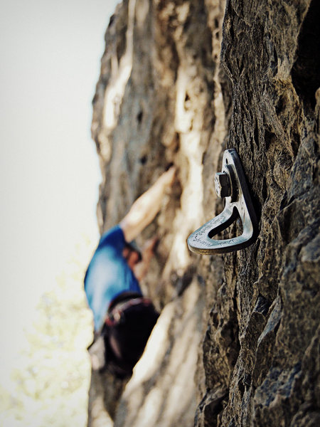 John Ross, climbing shiny. Pictured bolt is the first on Stone Cold Xiaosho (Nikon PL510)