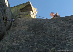 Rock Climbing Photo: The dicey step-around to a spacious belay.