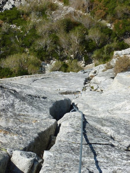 A good belay stance 20 meters above the roof pull.  From here, one long final pitch remains.