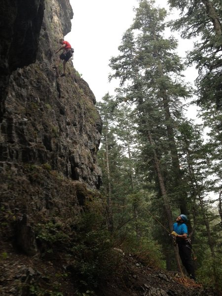 DK lowering off of the FA of [[108326364]] 5.9 in a sudden rain shower.<br> <br> (Photo by Kip Henrie)