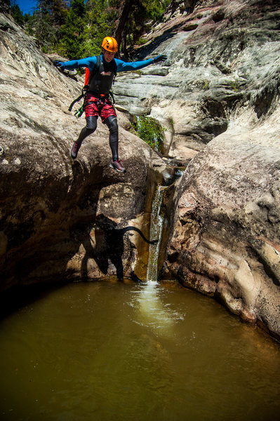 Jumping the largest pothole in the narrows section of Hay's Creek. <br> Photo credit: Nathan Klammer