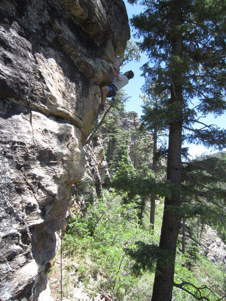 Dan Greenwald cranking the first ascent of Fathers Day