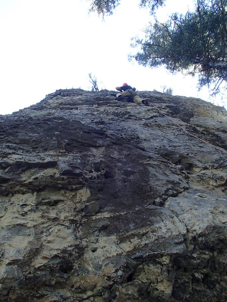 Darren in the middle of the steep jugs on Reaver.<br> Photo by Jennifer Knezek.