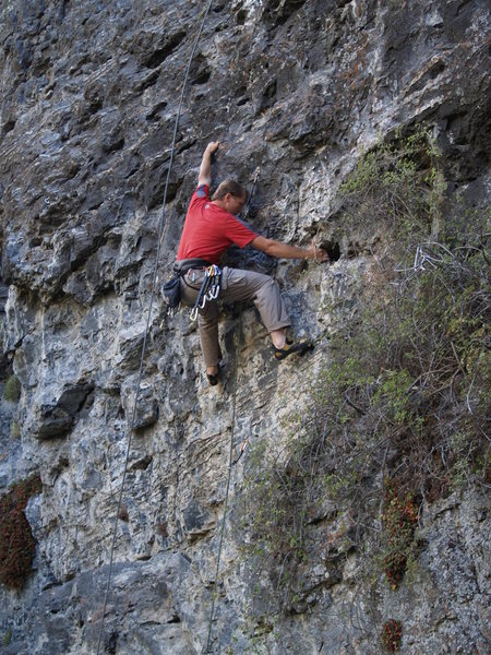 Doing a reachy move at the 3rd bolt using good holds.<br> <br> (photo by Perin Blanchard)