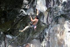 Rock Climbing Photo: Tim Greene sticking the throw to the brick