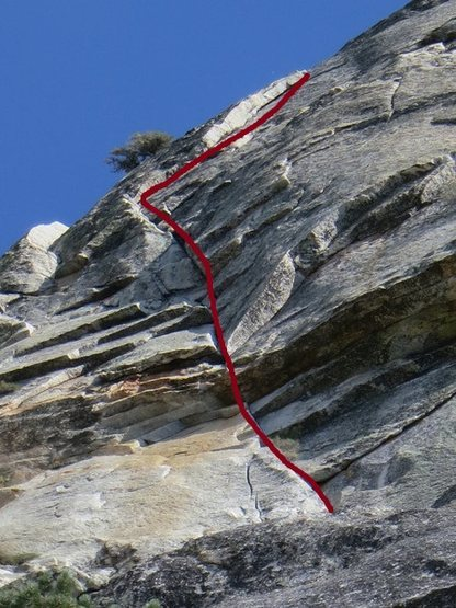 The route follows the line to the top towards the tree and then goes right following the flake.