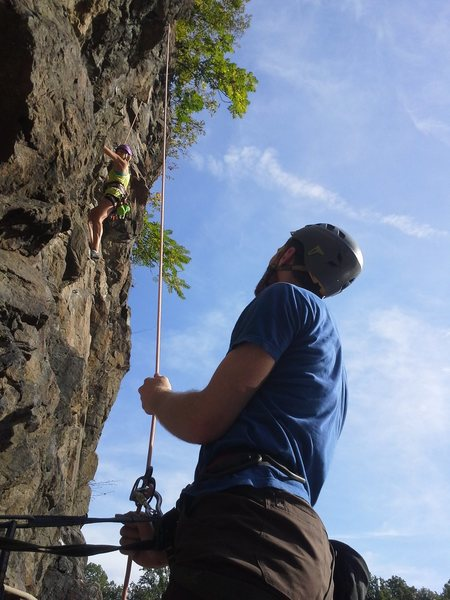 Ben belaying Alexis as she heads up