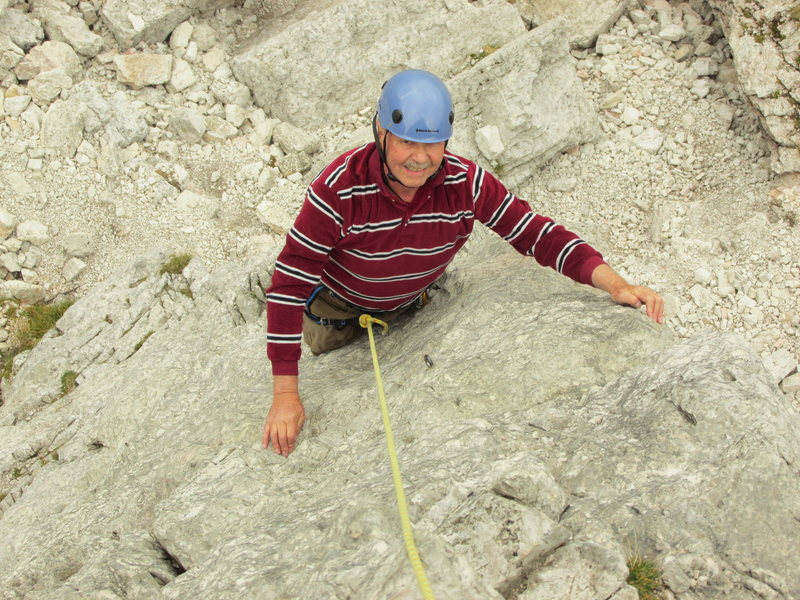 Me, on the first pitch of Torre Lusy. This ascent was made on the 50th Anniversary of my earlier climb of the route on 8 September 1963. This was my first introduction to climbing in the Cortina area at Cinque Torri.