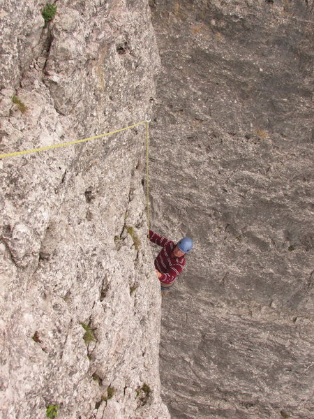 Climbing 4th lead, Torre Lusy. This pitch is steep but endowed with very good holds keeping the difficulty at UIAA IV-, or YDS 5.4.