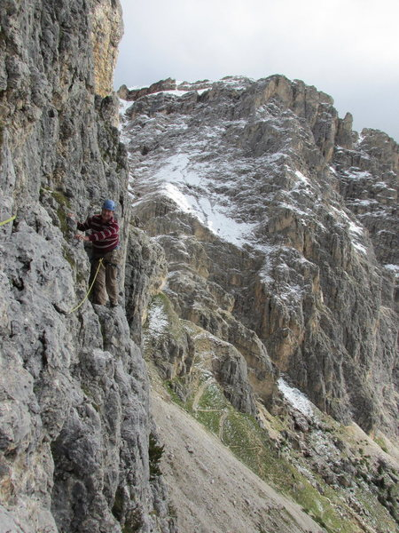 The easy but exposed traverse on pitch 2 of via della Guida.