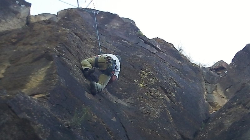Tom Allard working the pockets up the face.
