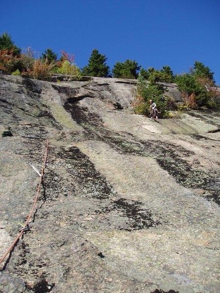 Sir Bors Dream-Top of P1, looking at P2 (slab above and left of belayer, leading to overlap)