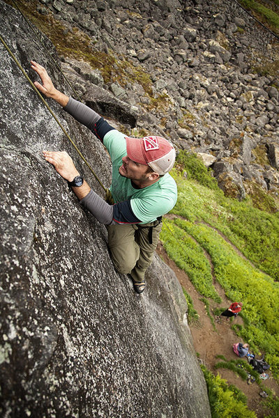 Aaron nears the end of the slabby crux of Center Slab Left in Archangel Valley, Alaska, on his first day of climbing ever. July 2013.