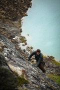 Rock Climbing Photo: Lower Reed Lake provides a backdrop as Matt moves ...