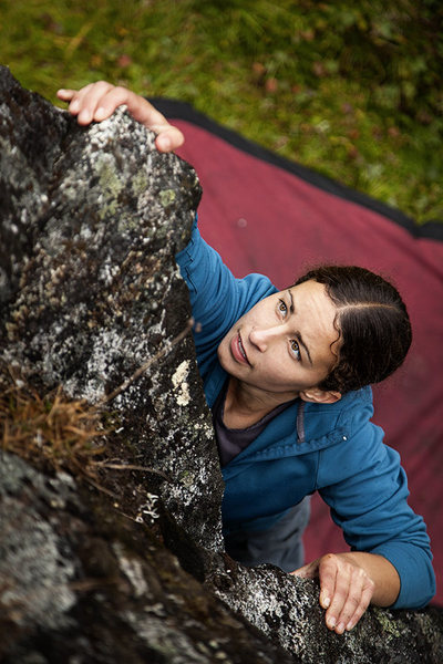Amy climbs The Pampering to round off a very wet day of bouldering in the rain in Archangel Valley, Alaska. August 2013.