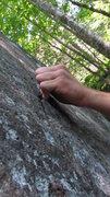 Rock Climbing Photo: The tiny left hand crimp.