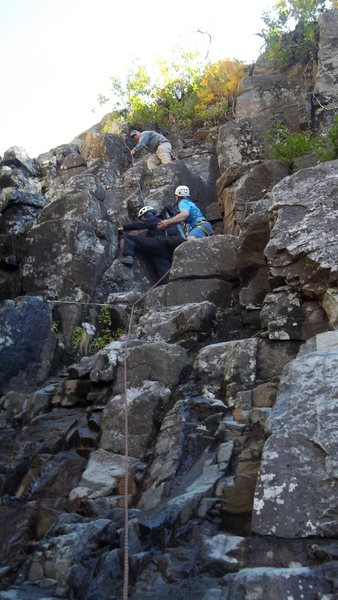 An older woman (70) was  perhaps ill-prepared for the dike was stuck here at the crux waterfall for 20 min before being helped by our group. The spot is actually steeper than it looks. The waterfall can not be seen just left of the pic.