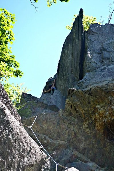 Chloe Quinn on the 1st ascent of her awesome route, Cozened Stone, 5.9 Rumney, NH