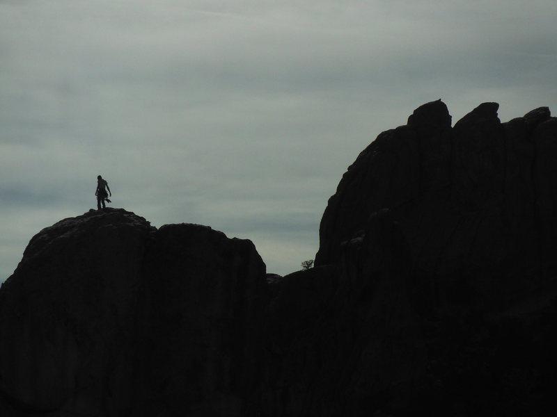 A view from Upper Comp. Unknown climber atop Brack' Pillar